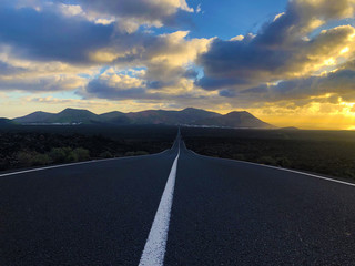 Endless road at sunset in the countryside of Lanzarote