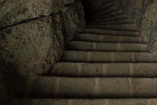 stone dungeon cave dark downstairs path way on shadow perspective foreshortening