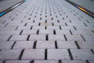 Straßenpflaster im Gleis
