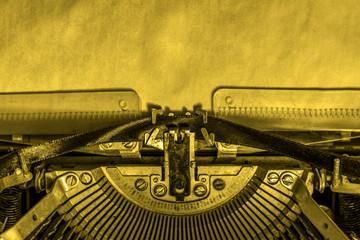 a blank sheet of paper inserted into a retro typewriter. writer, journalist.