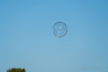 Soap bubbles with sky background.