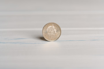 Back side of a 20 CHF Swiss Rappen coin standing on a table