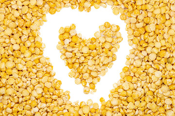 5f774b65a Yellow split dried peas, heart-shaped, close up, macro, top view