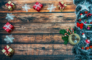 Christmas decoration and Christmas gifts on wooden background. Christmas background, with place for text, copy space.