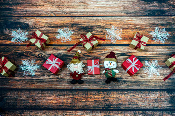 Christmas holiday background with gift boxes and decorations on wooden table. High angle view
