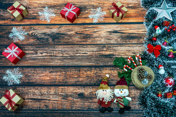 Christmas decoration and Christmas gifts on wooden background