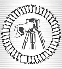 Camera and photos on a gray