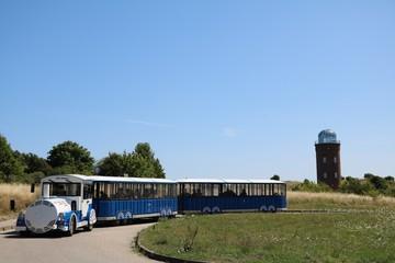 Tourist train and Lighthouse Peilturm at Cape Arkona on Island of Rügen, Germany Baltic Sea