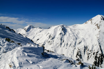Winter landscape with hills covered with snow at Pirin Mountain, view from Todorka peak, Bulgaria