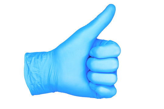 a photo of isolated hand glove thumb up / hand in position thumb up