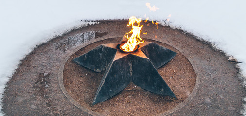 eternal flame in winter