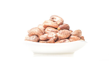 Roasted cashew nuts isolated with china bowl on white background