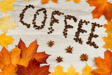 Coffee beans on a light wooden surface. Background