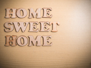 Home Sweet Home in Wooden Word Concept