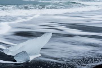 Chunks of ice broken from a glacier on Diamond Beach, a black sand beach in Iceland