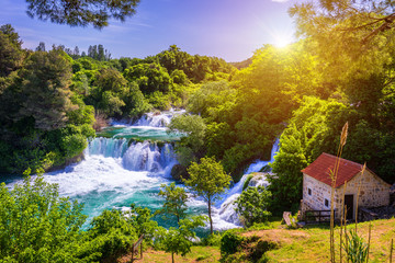 Waterfalls Krka, National Park, Dalmatia, Croatia. View of Krka National Park, Roski Slap location, Croatia, Europe. Beautiful world of Mediterranean countries. Traveling concept background. Wall mural