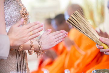 The monks praying and bless by holy water for Wedding ceremony