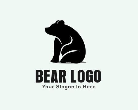 simple unique sitting lazy bear logo design inspiration