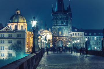 Charles bridge in Prague, Czech republic, at nighttime. Beautiful travel background.