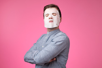 Mature european man in a cosmetic mask for skin care