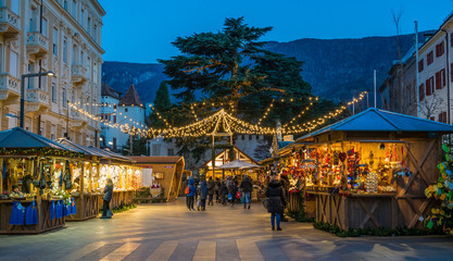 Merano Christmas market in the evening, Trentino Alto Adige, northern Italy. Wall mural