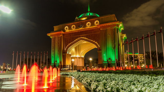 Colorful fountain at the gate to Emirates Palace night timelapse, UAE.
