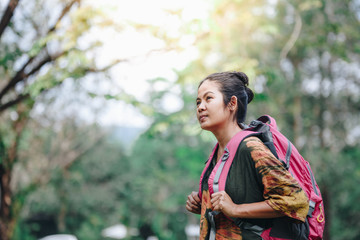 Traveler backpacker asian woman with nature background , concept travel , copy space