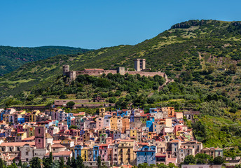 Panorama of scenic Bosa village and fortress, Sardinia, Italy