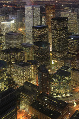 Vertical aerial of Toronto cityscape at night