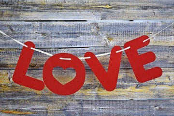 Valentine's day.The inscription in red letters on a wooden background.
