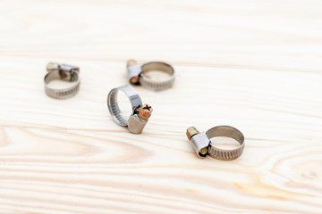 natural background. metal clamp for car repair. shallow depth of field. there is toning