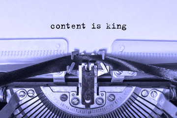 content is king printed on a piece of paper on a vintage typewriter.