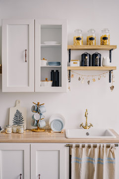 The interior of the bright kitchen in the Scandinavian style