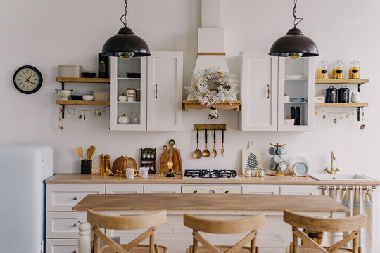 The interior of the bright kitchen with a bar in the Scandinavian style