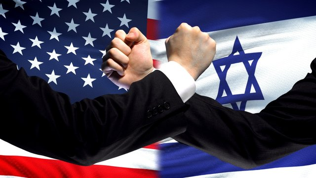 US vs Israel confrontation, countries disagreement, fists on flag background