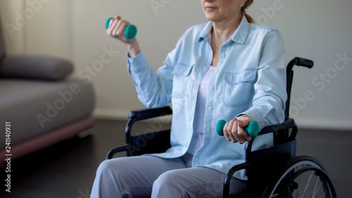 Handicapped Woman Lifting Dumbbells Rehabilitation After Car
