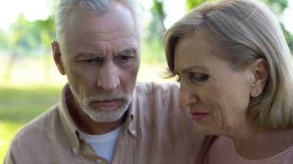 Desperate husband and wife thinking of problem, health problem, looking stressed