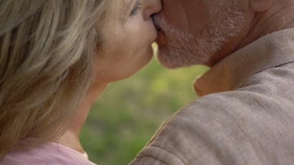 Senior couple kissing, strong marriage after long years of living together