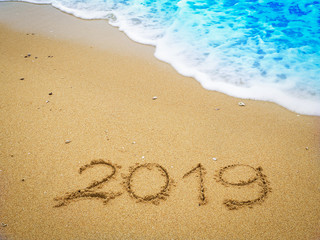Year 2019 on the beach for background