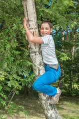 Little boy climbing on tree