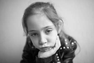Portrait of a little girl in a rocker jacket