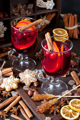 Winter  hot drink with spices and tasty cookies