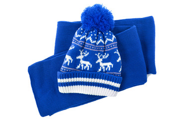 Blue knitted scarf winter bobble hat isolated white background