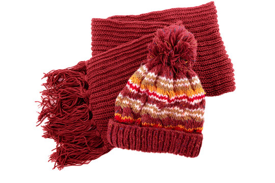 Chunky red knitted winter bobble hat scarf isolated white background