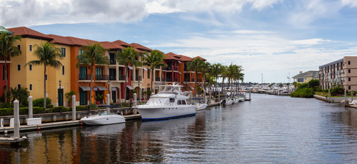 Panoramic view of Vacation Resorts by the river during a vibrant sunny day. Taken in Naples, Florida, United States.