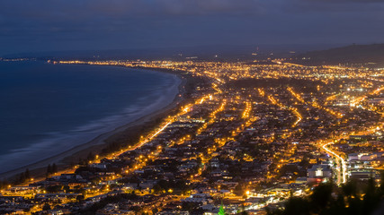 This is the city of Tauranga, New Zealand. This photo is taken from Mount Maunganui. From here, one can see this mesmerizing city from the top. The lights are beautiful to look at.