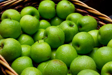 A basket of fresh green apples.