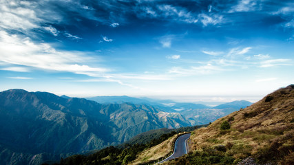This photo was taken in Taiwan. High up in the mountain, one can see mountain ranges, alpine trees and beautiful cloud formation. One can see really far into the distant. This image is breathtaking. Wall mural