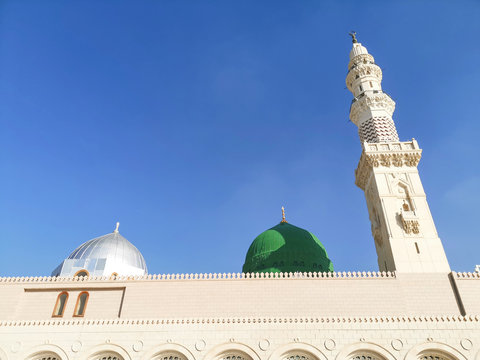 Medina, Saudi Arabia - March 25, 2018: Green dome closeup at Prophet Muhammad SAW's Mosque or Nabawi Mosque at Madinah, Saudi Arabia with selective focus and crop fragment