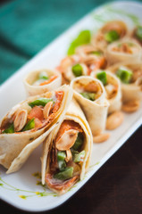 Sushi-Style Wraps with chicken pepperoni, vegetables and nuts. Healthy snacks.